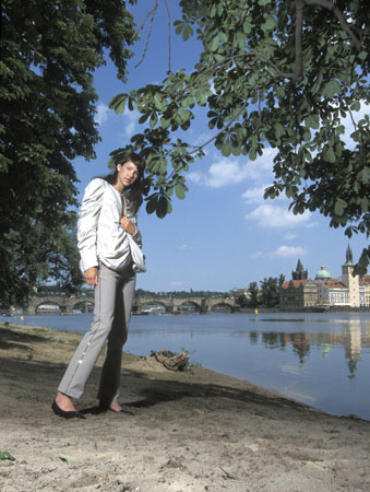 Girl on Prague river bank